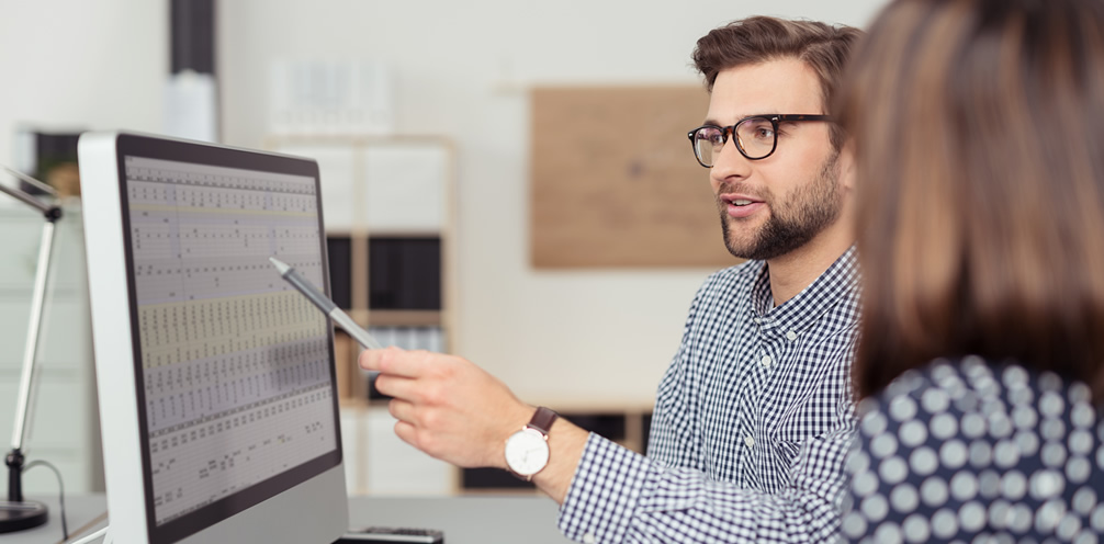people pointing at computer screen