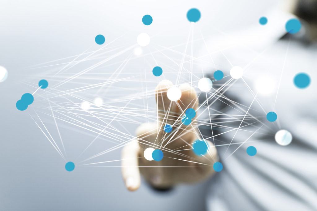 person touching interconnected dots